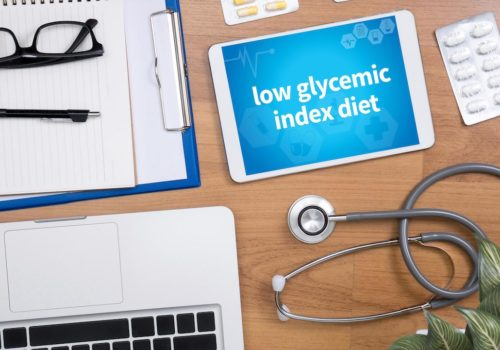 low glycemic index diet Professional doctor use computer and medical equipment all around, desktop top view